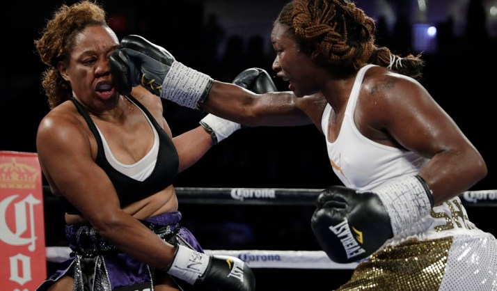 Franchon Crews, left, and Claressa Shields fight during a women's super middleweight bout, Saturday, Nov. 19, 2016, in Las Vegas. (AP Photo/John Locher) ORG XMIT: NVJL103