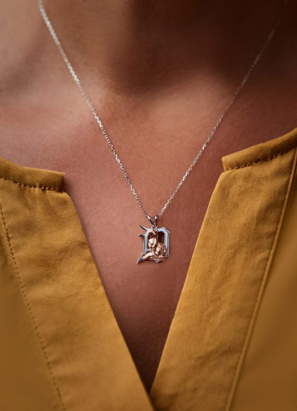 a small fox pendant necklace on a human