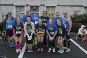 """Pre-race, classic Team G """"hands on knees"""" pose"""