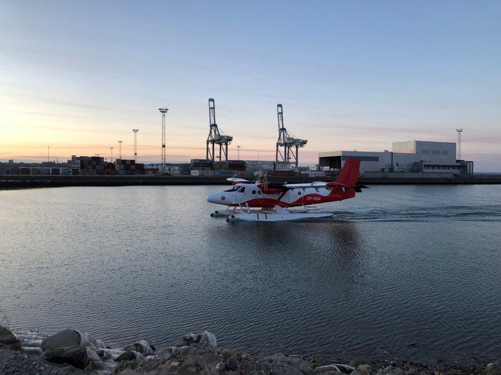 Nordic Seaplanes twin otter on floats coming into the bay.