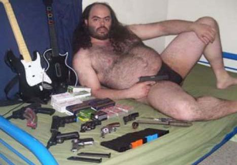 bearded redneck in tho modeling with guns and guitars