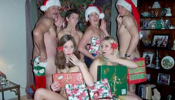 Awkward family Christmas card ~ Family posing nude with presents