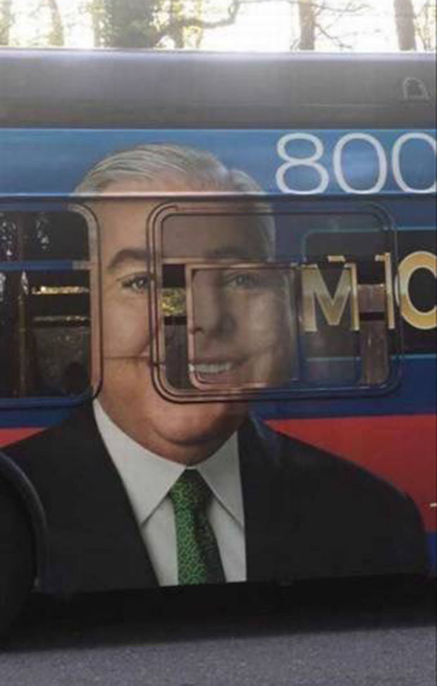 Unfortunate ad placement on bus, face window