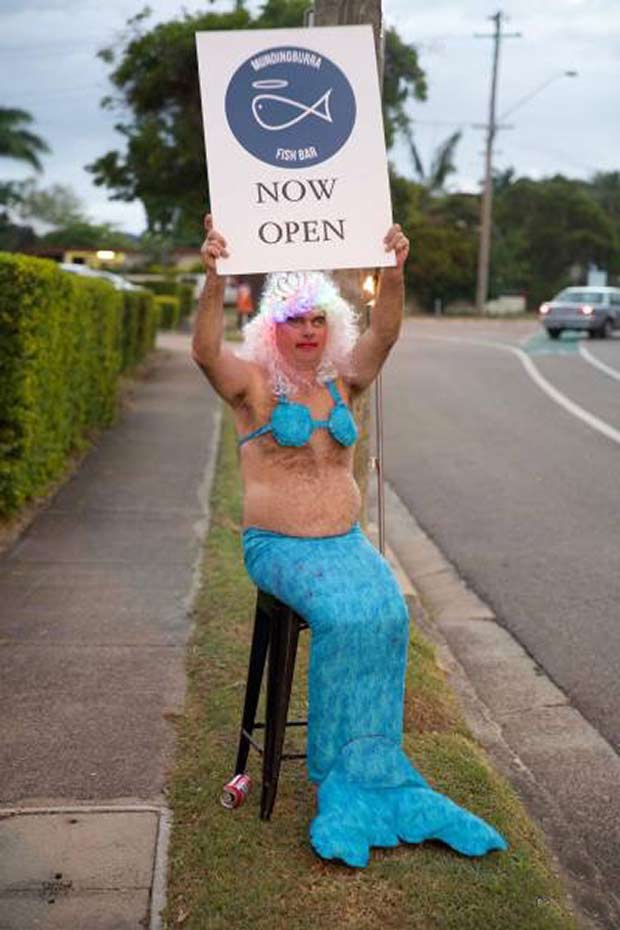 Who can resist a man in an awesome mermaid costume promoting a fish bar?
