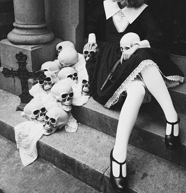 cool vintage snap of woman and skulls on steps