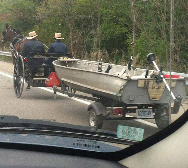 Hopefully the fish will still be biting when the y get there! ~~ Amish buggy pulling motor boat
