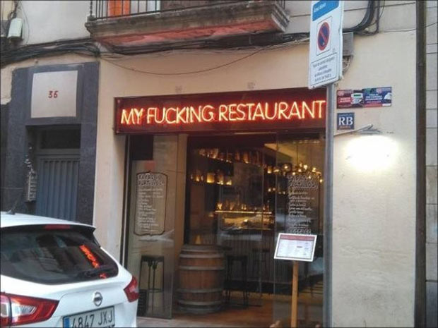 Can't tell if the owner is jacked or displeased over the fact he has a restaurant ... funny signs