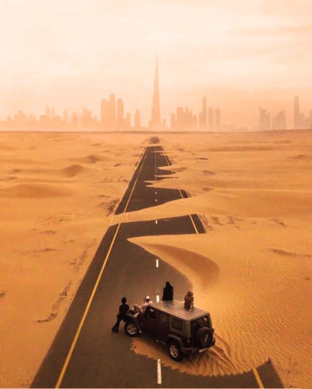 Highway into Dubai, sand dunes covering road