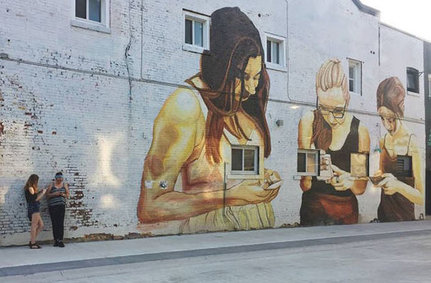 Truth in Art ~ great building mural, girls on cell phones