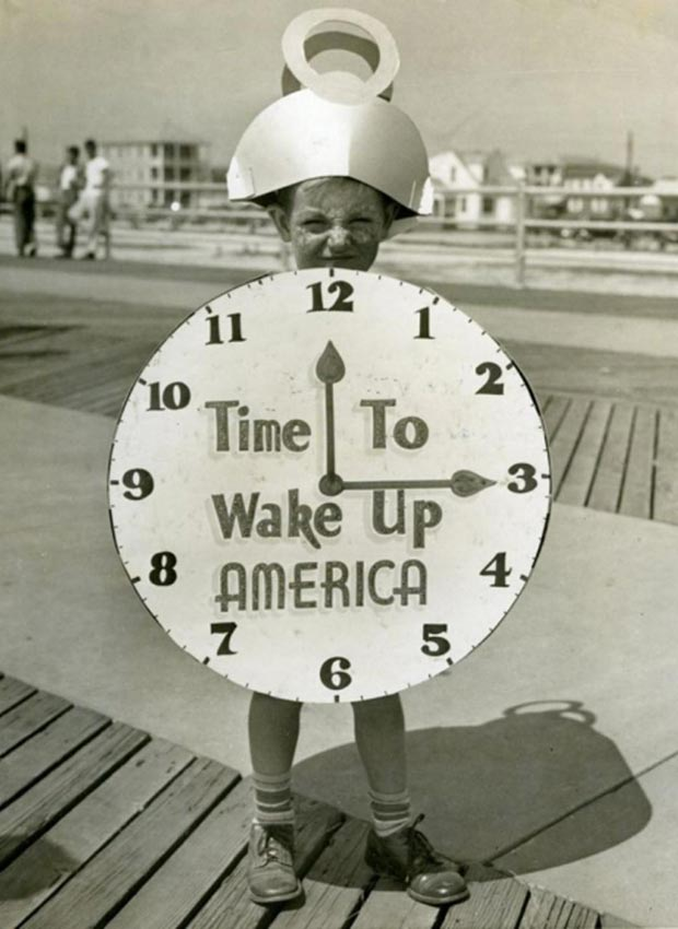 Vintage pic of kid in alarm clock costume Time to Wake Up America