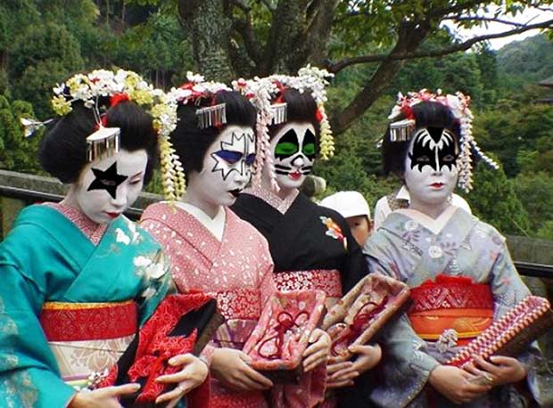 Rock on! ~ Japanese geisha's in traditional dress with faces painted in Kiss makeup