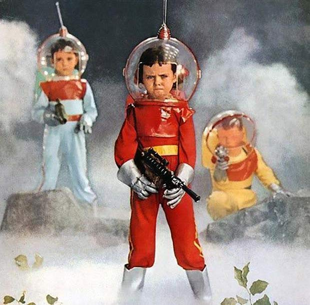Vintage ad of kids dressed as astronauts with laser guns. 1950s