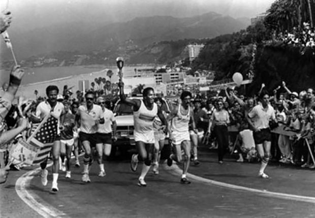 O.J. Simpson carries the Olympic Torch in Los Angeles, 1984. Nichole Brown can be seen on the left.