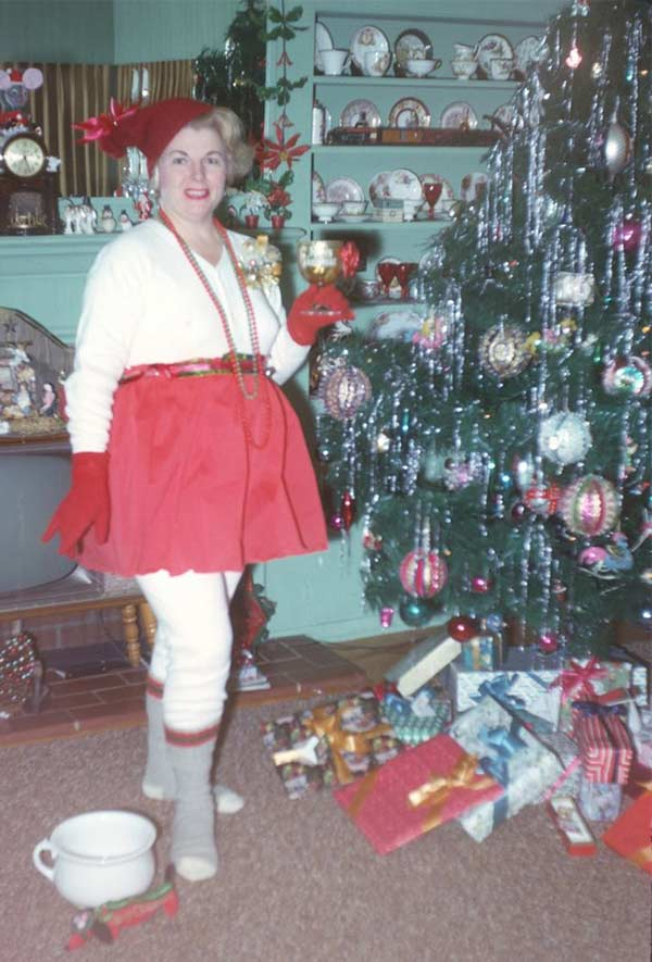 Is that a pee pot next to that crazy elf? ~~ awkward family Christmas photo ~ woman dressed as elf