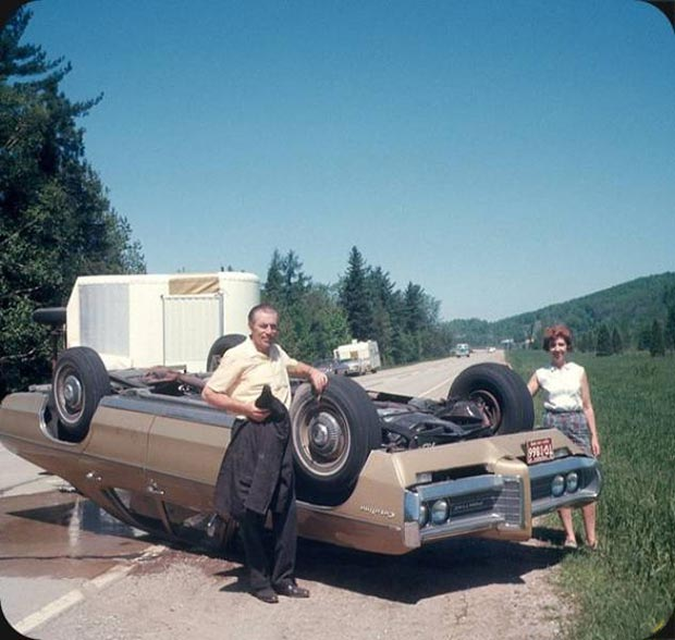 Frank and Nellie's annual vacation got off to a booming start. ~.~funny awkward family vintage photos, car accident, roll over man woman posing with wrecked car gasoline leaking