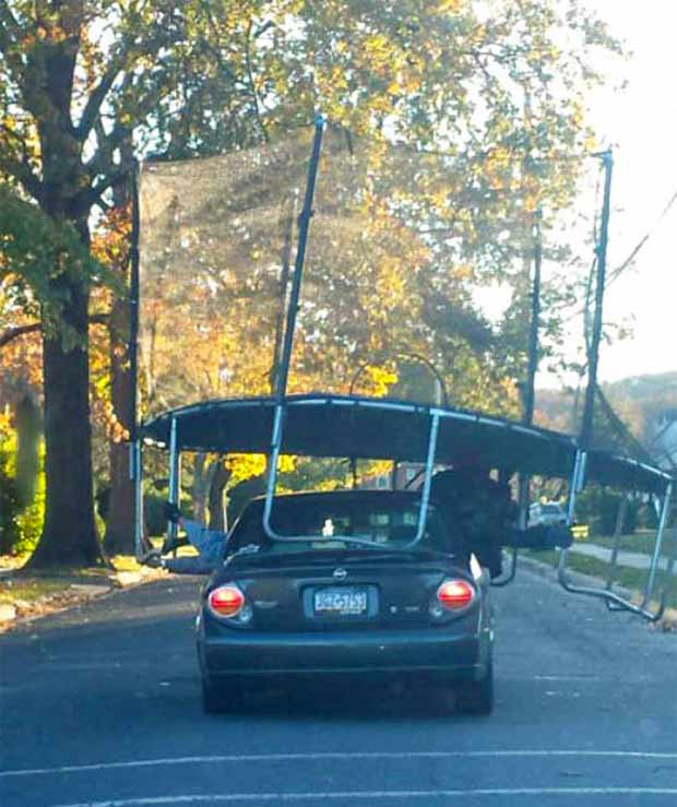 33 Funny Pics and Memes of the Day ~ Redneck engineering hauling trampoline on top of car