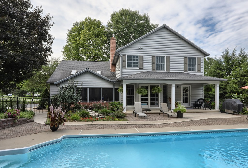 Tastefully appointed custom home with backyard oasis