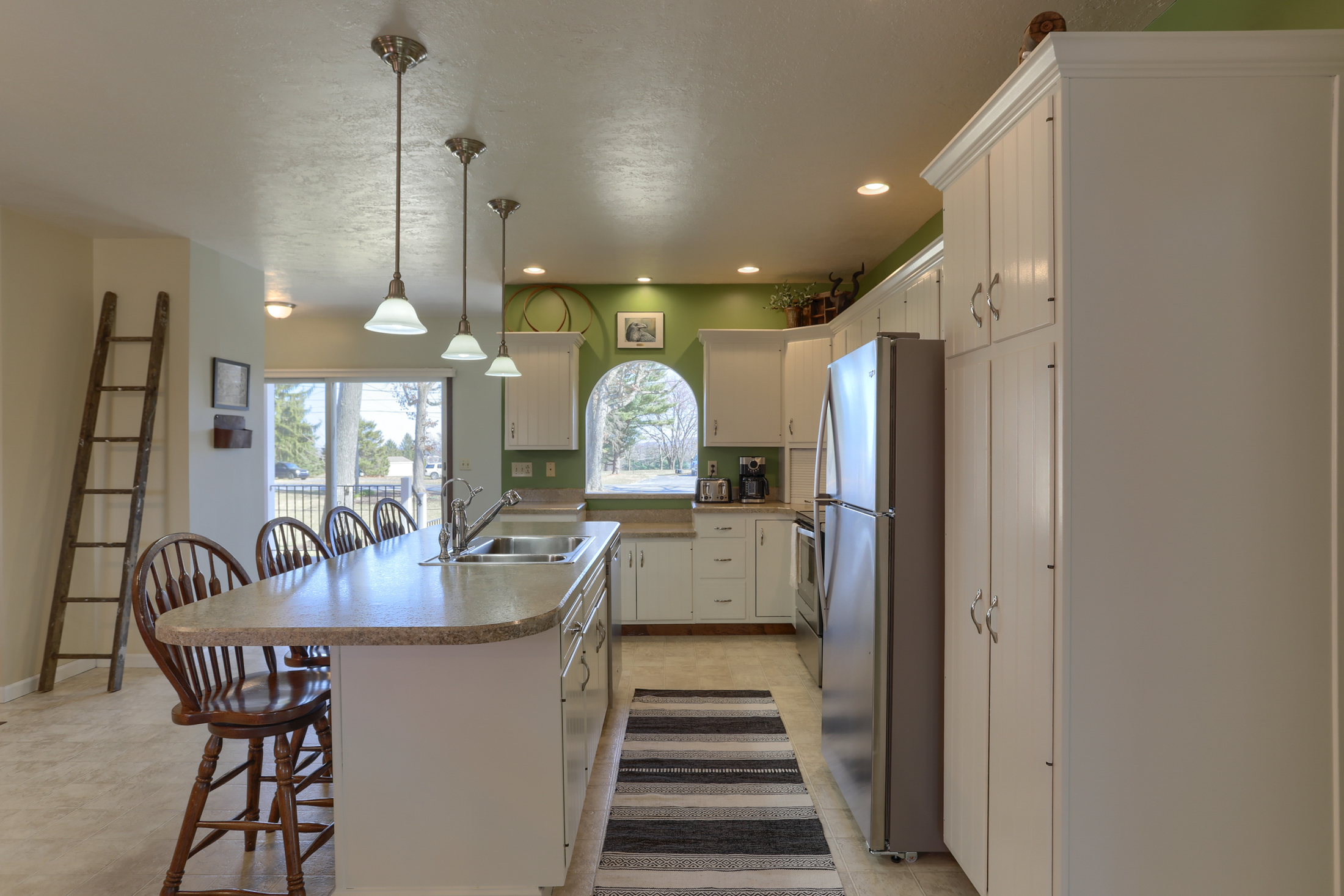 285 Strack Drive - Kitchen with all new appliances and view of quiet wooded setting