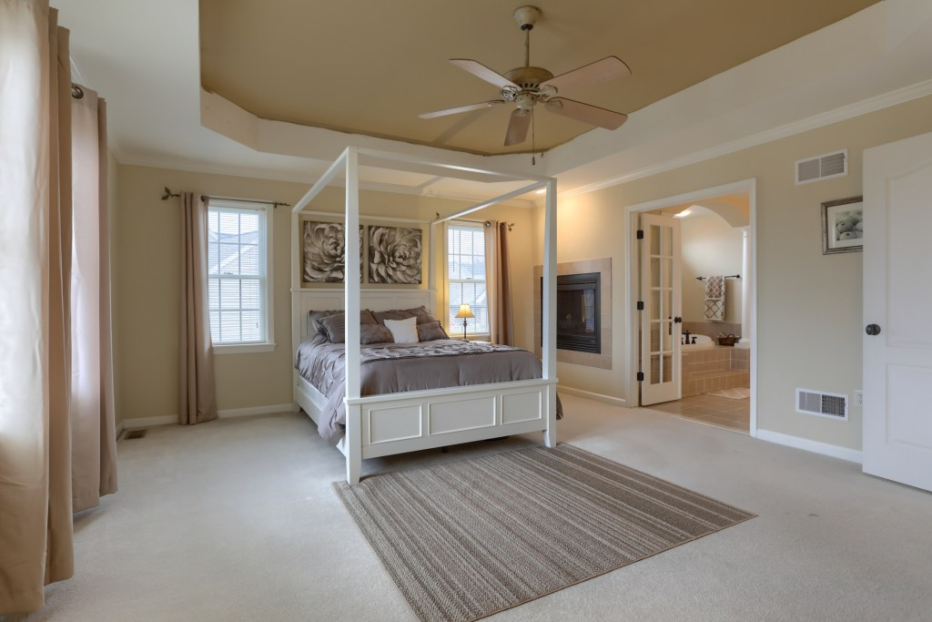 2000 mallard lane - primary bedroom with gas fireplace