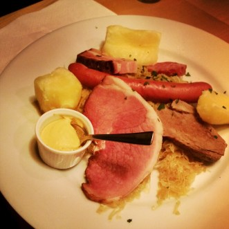 Berner plate: Sausages and various meats, boiled potato on a bed of sauerkraut. Not for vegetarians.