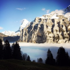 Above the clouds and below the Peaks. The Eiger looms in the background: the white peak on the right)