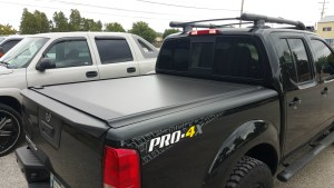 2016 Nissan Frontier PRO-4X with Retrax One MX bed cover