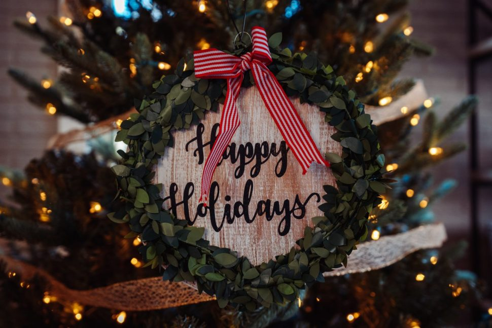 selective focus photo of Happy Holidays board decor