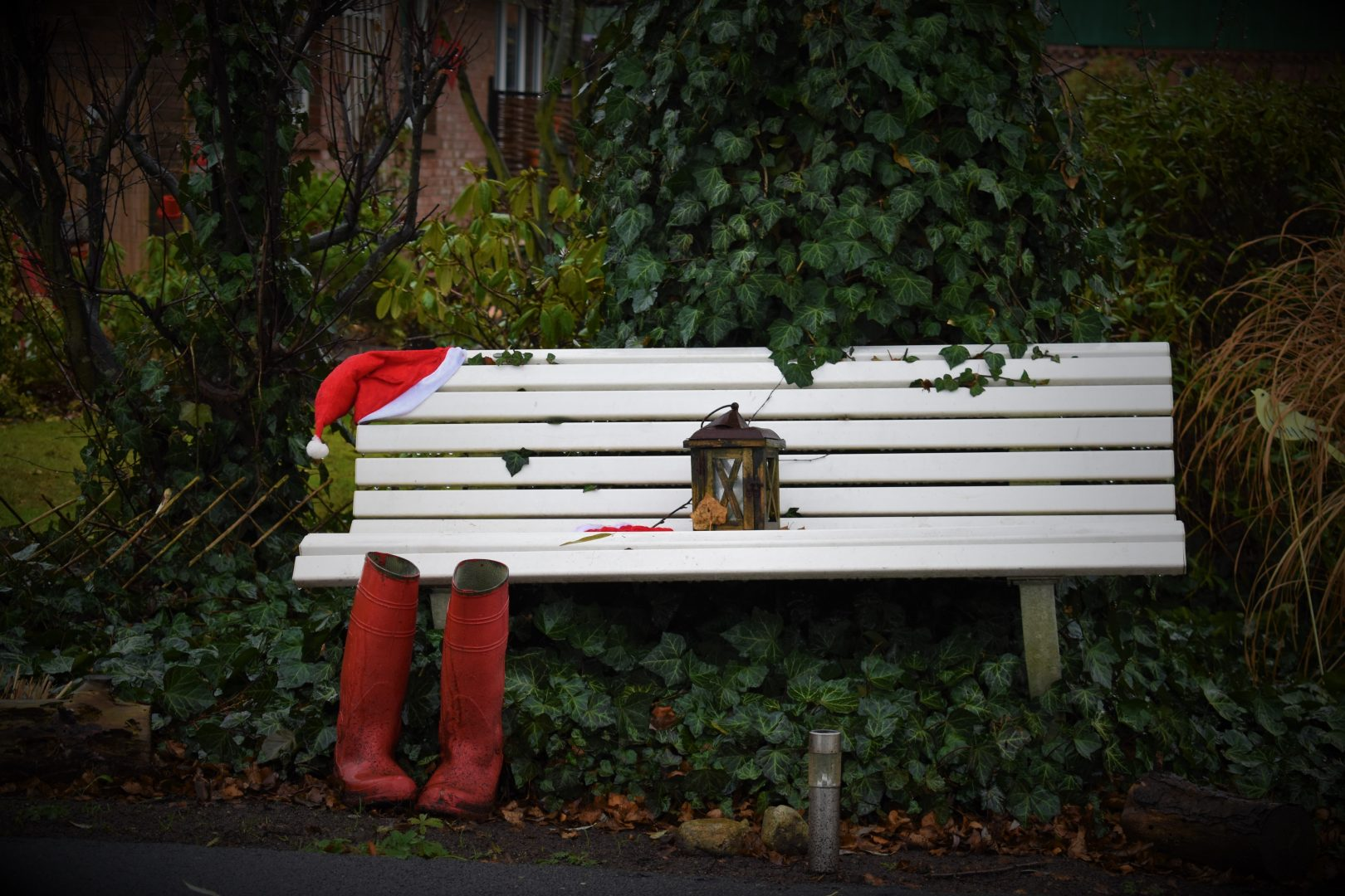 pair of red boots near white bench