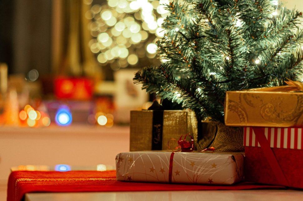 brown cardboard box beside green christmas tree