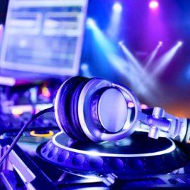 Dj mixer with headphones at nightclub