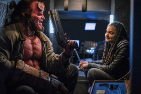 Hellboy and black girl with dreadlocks
