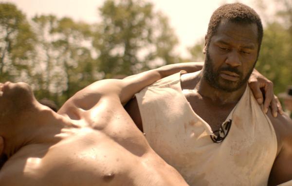 The North Star Movie - Benjamin Jones (Jeremiah Trotter) carries Lewis (John Wooten).
