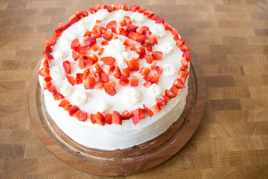 Strawberry cake with prosecco frosting is light and fluffy, just the right amount of sweet, and the perfect sweet bite of spring!