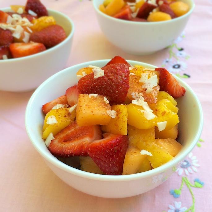 A fruit pico de gallo featuring strawberries, mango, melon, coconut and cayenne pepper - check out the recipe at Teaspoonofspice.com #strawberries #mango #picodegallo #fruitcup #smokedpaprika