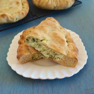 Stuff roasted broccoli with white pizza toppings (ricotta, mozzarella & Parmesan) to make these homemade calzones that are pizza parlor worthy. Teaspoonofspice.com @tspbasil