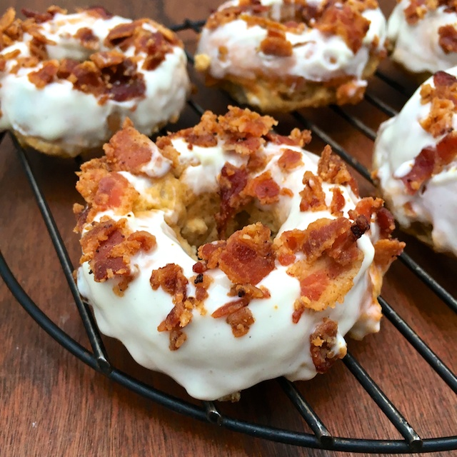 Celebrate St. Patty's Day with these baked donuts covered with whiskey bacon frosting made with Greek yogurt! @tspbasil @healthyaperture