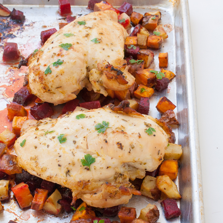 Throw 6 ingredients on a sheet pan and wait for dinner to come out as tender roast chicken and crispy golden veggies: LEMON OREGANO SHEET PAN CHICKEN | @TspCurry #AD For more chicken recipes: TeaspoonOfSpice.com