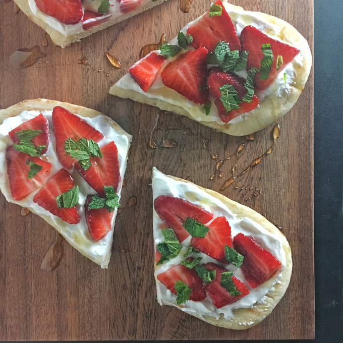 An easy-to-make, not-too-sweet dessert featuring strawberries, whipped cream, yogurt, honey and naan flatbread.