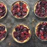 Use Mason jar lids to make portion sized mini fruit pies and tarts! Recipe at Teaspoonofspice.com