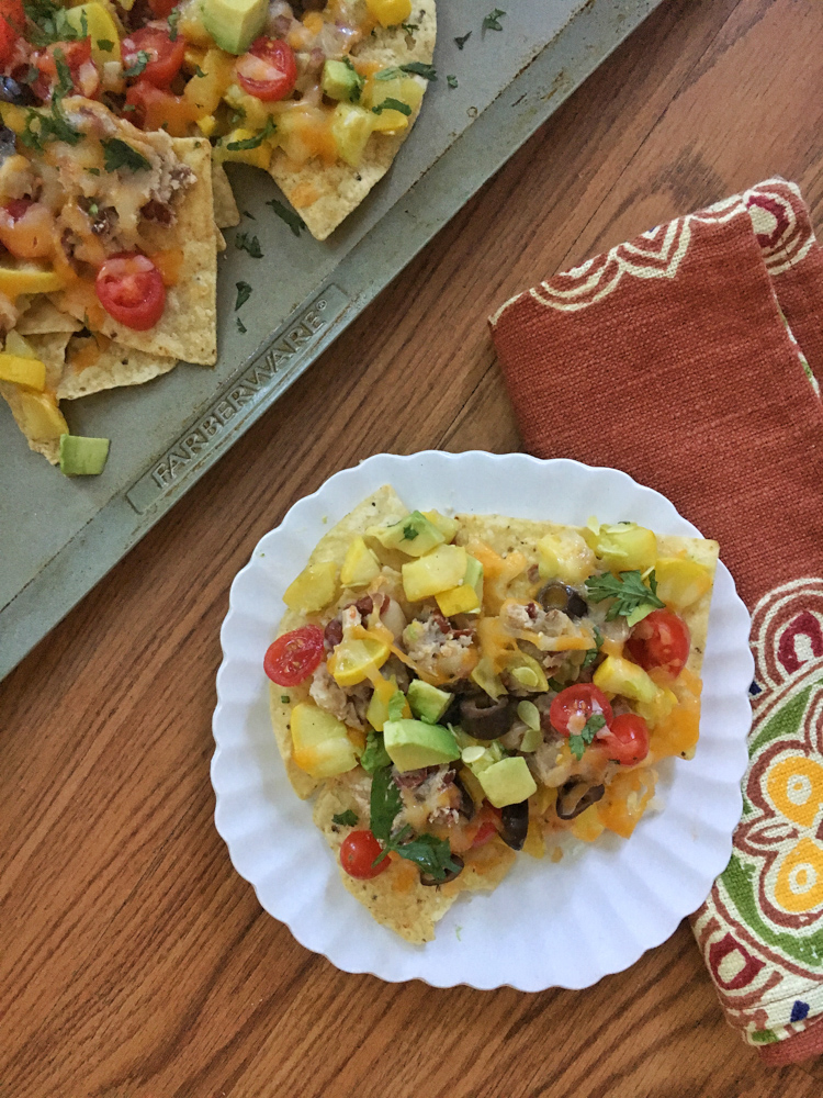 Nachos for breakfast? This dietitian says yes if they're packed with beans and veggies! Summer Squash Nachos recipes at Teaspoonofspice.com