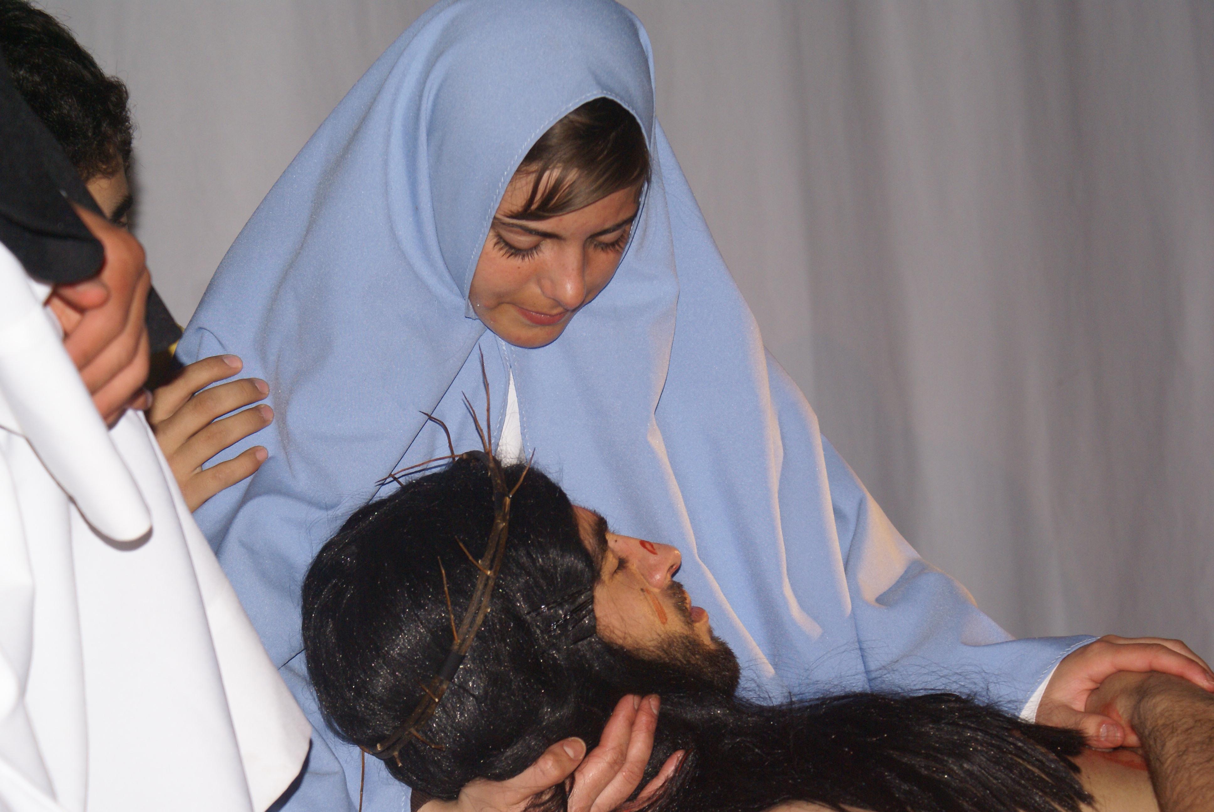 Jesus nos braços de sua mãe
