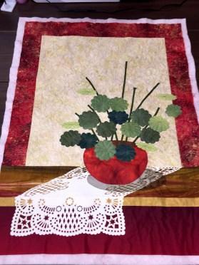 Appliqued geranium quilt by Lea