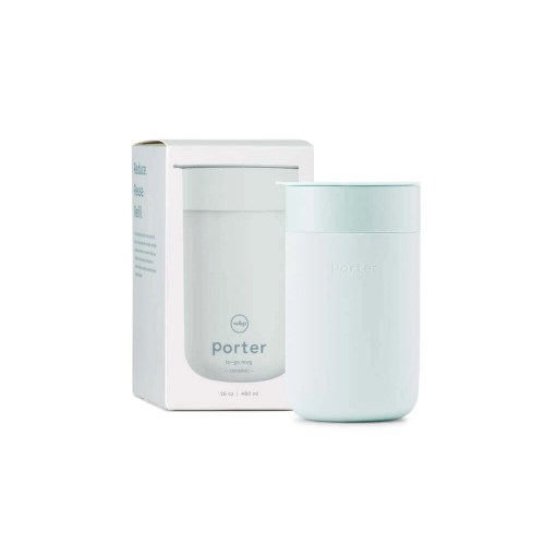 mint colored 16oz porter mug in front of product packaging