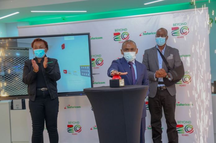 """Safaricom Chief Executive Officer Peter Ndegwa, Launches the newly refurbished heavy tech shop in Moi avenue, Nairobi. Their plan is to offer integrated solutions as part of our strategy to drive digital inclusion"""" This first-of-a-kind digitized flagship shop has a video tunnel at the entrance, digital interactive screens and device display screens for a wide variety of phones and accessories on sale together with Safaricom Chief Customer Officer Sylvia Mulinge and Chief Human resource officer Paul Kasimu."""