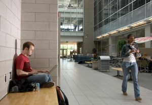 MSU student using a laptop on campus