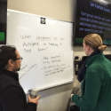 Two Instructors talking in front of a white board during an MSU Real Academy workshop