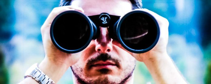 Man Spying Binoculars Watch Silver Outside Social Media Content