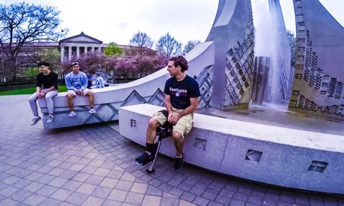 Clutch Crutch Gets Injured People On Their Feet Sitting Fountain Campus