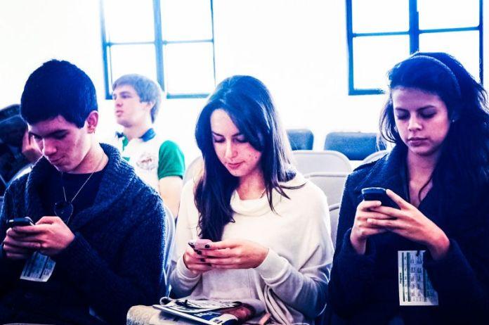 Social Media Millennials Group Staring At Smartphones Sitting Girls Boy Teenagers School Reading Texting Smartphones