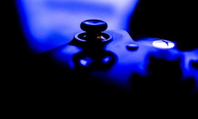 Xbox Scorpio Features Revealed in April One Microsoft Controller Blue Dark Background News Secret New Console Version Comparison PS4 Pro